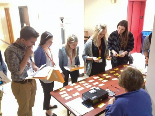 Students do a poverty simulation as part of the Wisconsin Express program, helping illustrate some of the difficult choices people in poverty face.