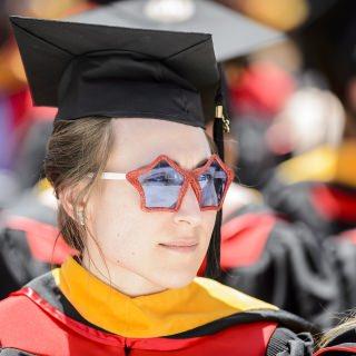 A graduate sports a pair of festive sunglasses.