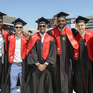 Graduating members of the UW men's basketball team - from left, Nigel Hayes, Zak Showalter, Jordan Hill, Vitto Brown and Bronson Koenig – with coach Greg Gard.