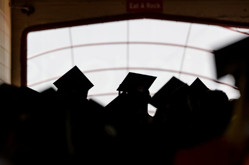 Soon-to-be graduates walk into the tunnel of Camp Randall Stadium at the University of Wisconsin–Madison before the start of UW–Madison's spring commencement ceremony at Camp Randall Stadium on May 13, 2017. The outdoor graduation is expected to be attended by more than 6,000 bachelor's and master's degree candidates, and their guests. (Photo by Jeff Miller/UW-Madison)