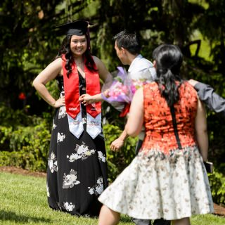 Graduate Dara Xiong is the center of attention following UW-Madison's spring commencement. Xiong is a PEOPLE Scholar graduating with a double major in human development and family studies, and theater and drama.