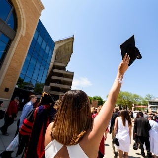 Soon-to-be graduates enter Camp Randall Stadium before Saturday's ceremony.