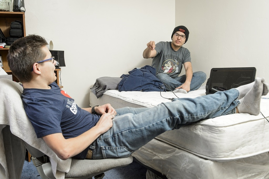 Michael Williams (left), student at Seymour Community High School in Seymour, WI, talks with his best friend Chris Gourd (right) in his home on the Oneida Indian Reservation on May 8, 2017. Both Williams and Gourd are participants in the Tribal Technology Institute outreach program created by the Division of Information Technology (DoIT) at the University of Wisconsin–Madison, which is designed as a college pipeline program for members of the Oneida Nation and Lac du Flambeau tribal communities in northern Wisconsin. In the program, students learn computer coding, website design and multimedia skills while working with mentors and completing internships. Additionally, the students also spend at the UW–Madison campus. (Photo by Bryce Richter / UW–Madison)