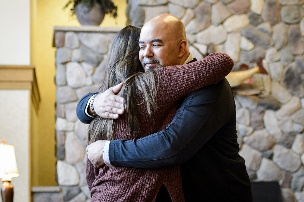 Kenadi Mayo (left), student at Lakeland Union High School in Woodruff, WI and member of the Chippewa tribal community, hugs Chris Kilgour (right), program manager of the UW Tribal Technology Institute (TTI) on May 1, 2017. Mayo is a participant in the TTI outreach program created by the Division of Information Technology (DoIT) at the University of Wisconsin–Madison, which is designed as a college pipeline program for members of the Oneida Nation and Lac du Flambeau tribal communities in northern Wisconsin. In the program, students learn computer coding, website design and multimedia skills while working with mentors and completing internships. Additionally, the students spend time at the UW–Madison campus. (Photo by Bryce Richter / UW–Madison)