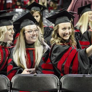 Pharmacy doctoral graduates Taryn Hinners, Lauren Arndt and Amy Hoffman (left to right) take a selfie.