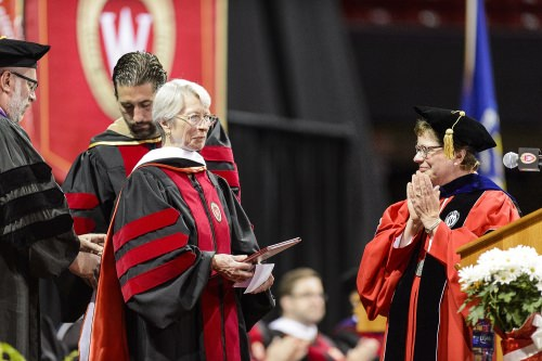 Tashia Morgridge receives an honorary degree during UW–Madison's spring commencement ceremony at the Kohl Center at the University of Wisconsin–Madison on May 12, 2017. The indoor graduation was attended by approximately 830 doctoral, MFA and medical student degree candidates, plus their guests. (Photo by Bryce Richter / UW–Madison)