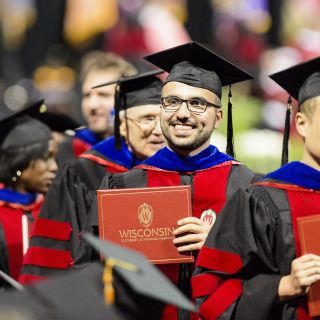 Newly designed robes brought more pops of red to the festivities.