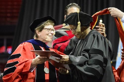 Cora Marrett (right) receives her honorary degree.