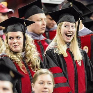 Tyler Bengtson shows her excitement about about receiving her doctorate in veterinary medicine.