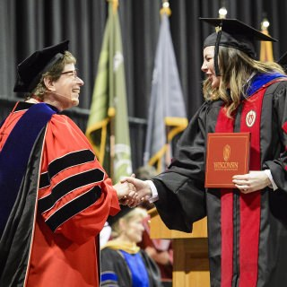 Chancellor Blank congratulates a graduate.