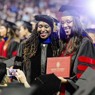 Graduates share a memorable moment.