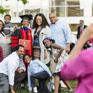 Communication Arts doctoral graduate Laura Stephenson takes a photo with her family after the ceremony.
