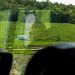 On the ride to La Farge, participants learned about Plain community settlements in western Wisconsin. An Amish schoolhouse can be seen from the bus.
