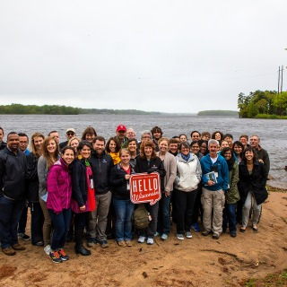 The group gathered at the Wisconsin River after learning about how stewardship of the river has evolved over the years.