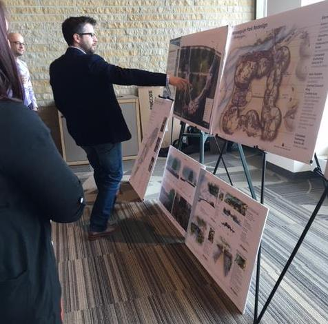People examine the plans for Monona created by UW–Madison students as part of UniverCity Year May 3 at DeJope Hall.