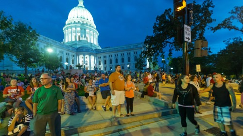 People watch a musical act at the 2014 Taste of Madison. Courtesy of John Benson.
