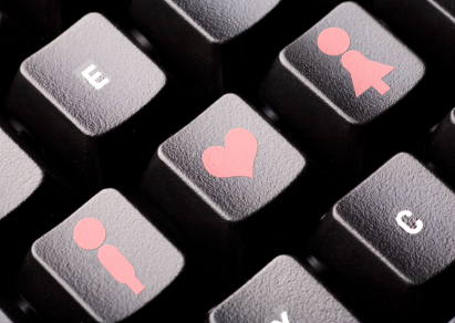 Man, woman, and heart icons on a computer keyboard