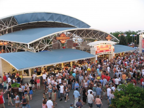 Summerfest attendees gather outside of one of the festival's 11 stages. Courtesy of Mike Bash