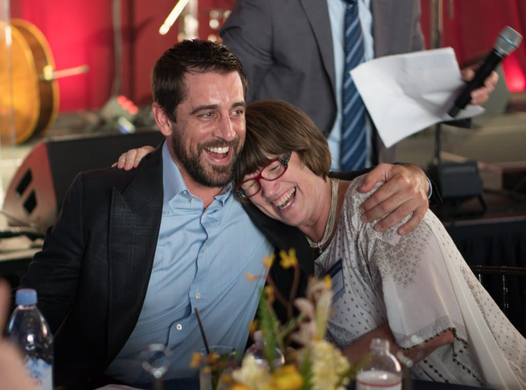 Aaron Rodgers and Susan North share a hug.