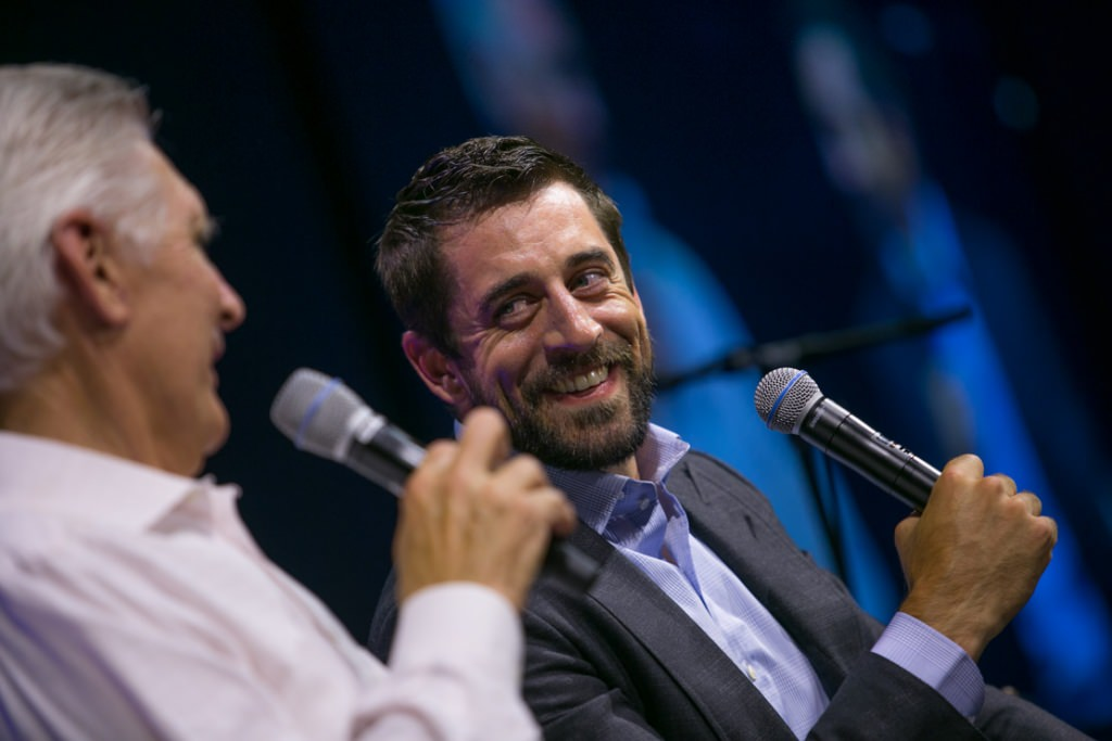 Andy North, left, and Packers quarterback Aaron Rodgers entertain the crowd.