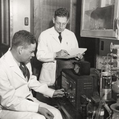 Photo: Robert Burris and Perry Wilson in lab