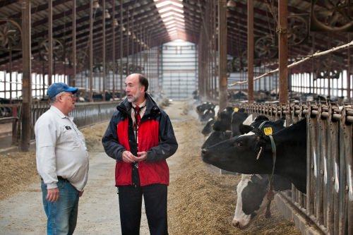 Photo: Byron Crouse talking to a dairy farmer
