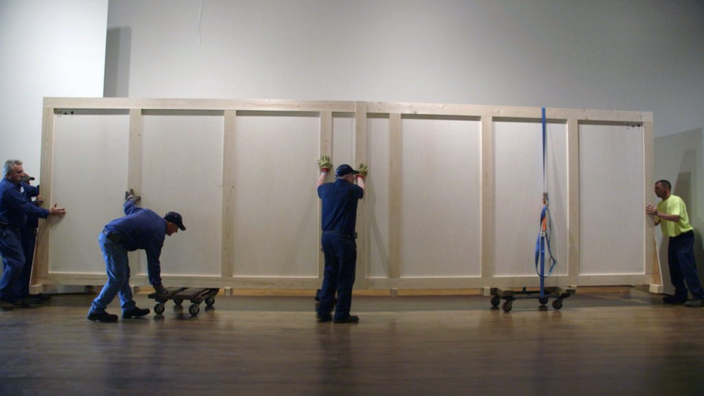 Workers bring the new art work by Jim Dine into the Chazen Museum of Art on Friday, June 9.