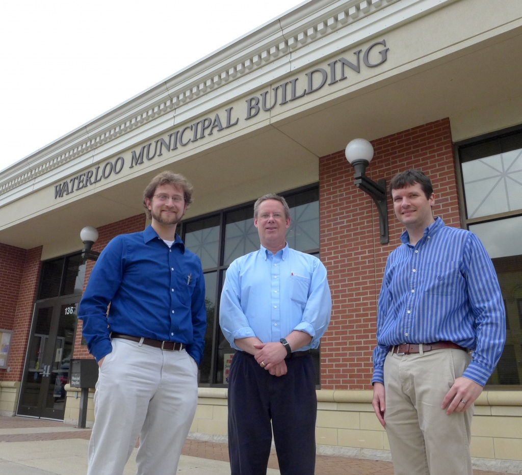 From left, Andrew Lewandowski, a pediatrician who heads the city's renewable energy committee, city clerk-treasurer Mo Hansen, and Scott Williams, research and education coordinator at the Wisconsin Energy Institute, in front of Waterloo City Hall.