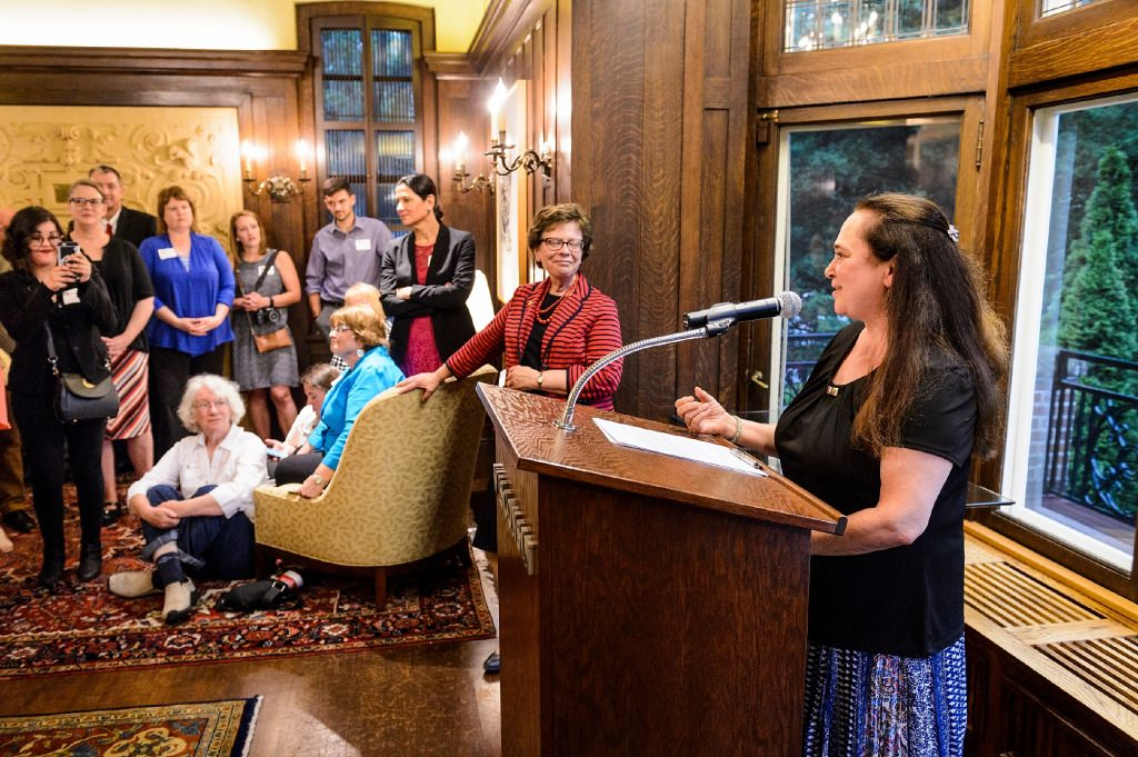 Emily Auerbach, professor of English at UW-Madison, receives the 2017 LaMarr Billups Community-University Engagement Award during a 2017 Community-University Partnership Award event at Olin House, the Chancellor's residence at the University of Wisconsin-Madison on June 28, 2017. Presenting the awards are UW-Madison Chancellor Rebecca Blank and Leslie Orrantia, UW-Madison director of community relations. (Photo by Jeff Miller / UW-Madison)