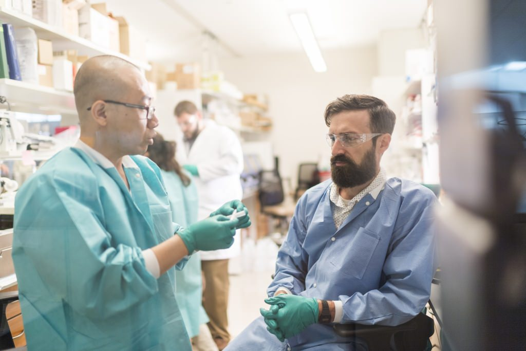 Photo: Jue Zhang and Matt Brown in lab