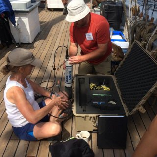 Cindy Hagley of Minnesota Sea Grant and Titus Seilheimer of Wisconsin Sea Grant fixing the Hydrolab on the S/V Denis Sullivan.