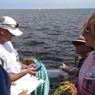 Crew members take water quality measurements in MIlwaukee Harbor.