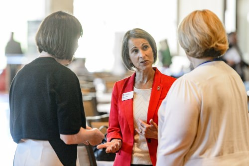 Photo: Susan LaBelle talking with 2 unidentified women