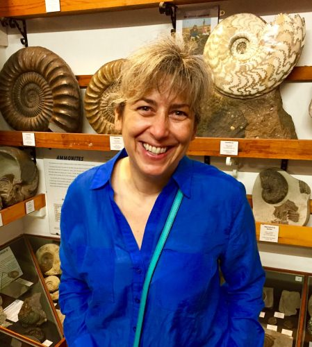 Photo: Pupa Gilbert standing in front of display of seashells