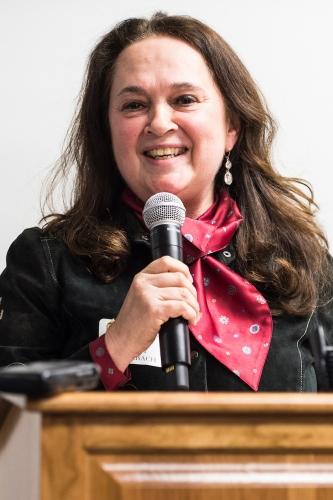 Photo: Emily Auerbach speaking at podium