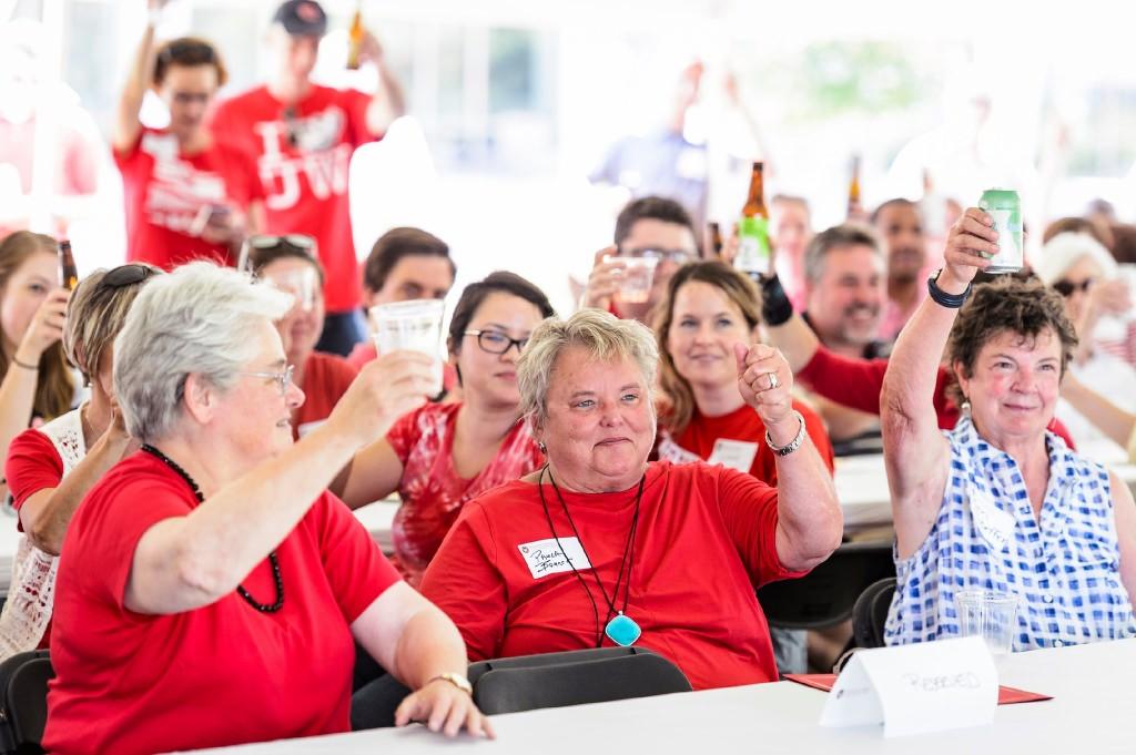 Bonner, center, smiles as she is honored. At left is Katharine Lyall, emerita president of the UW System. At right is Bonner's partner, Ann Schaffer.