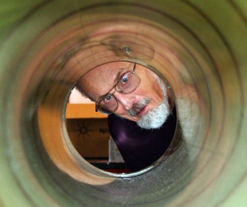 Photo: Charles Bentley peeking through the barrel of an ice drill
