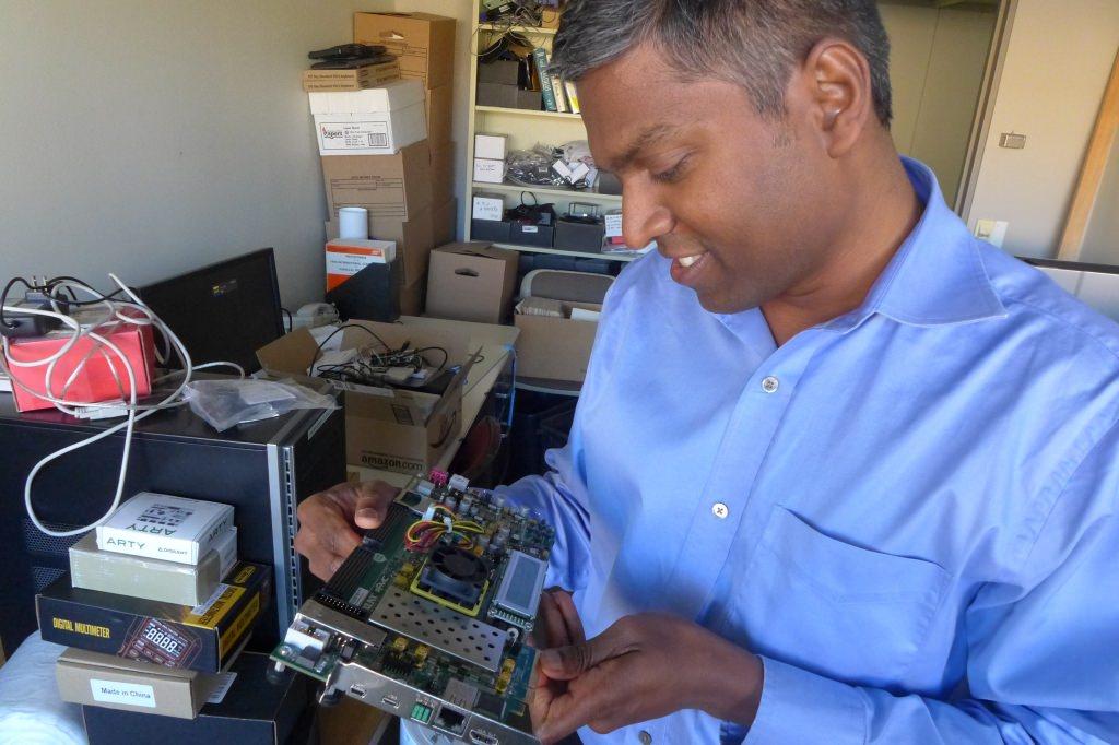 Photo: Karu Sankaralingam examines a prototype motherboard