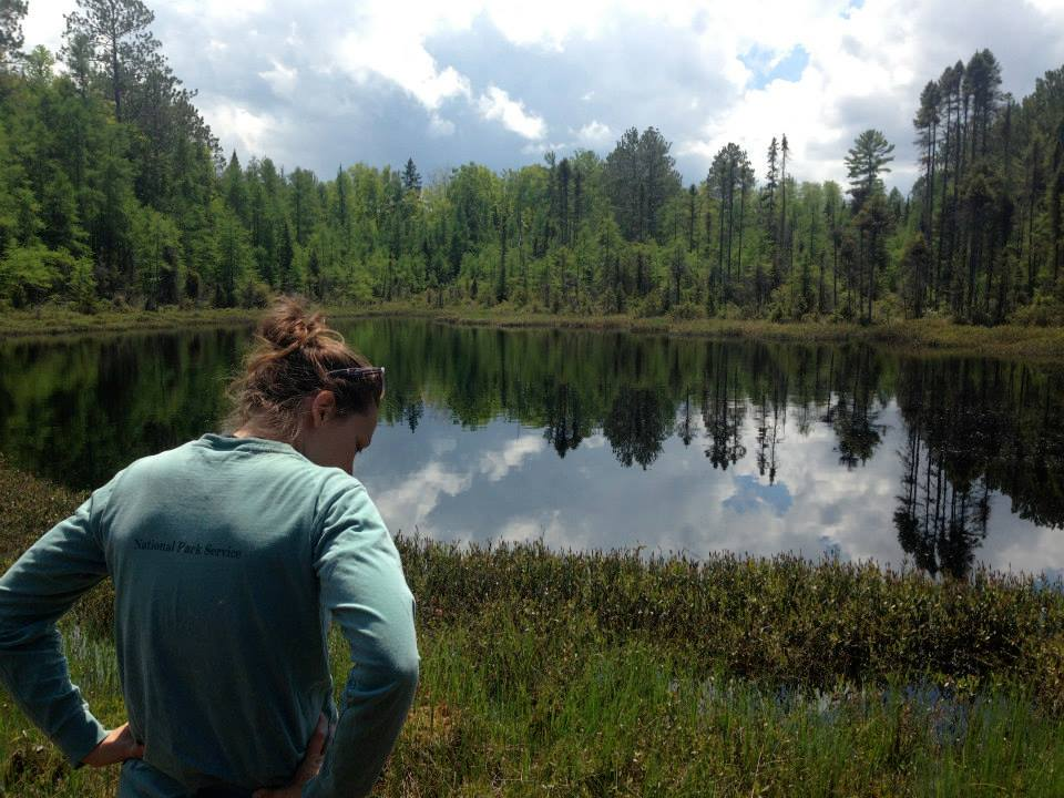 Photo: Samantha Oliver looking at a lake surrounded by trees