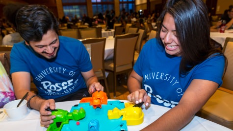 Syed Bukhari, and Kiana Gomez play a game of Hungry Hungry Hippos at the DDEEA Kick Back event.