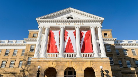 W banners hang from the columns of Bascom Hall at the University of Wisconsin-Madison during winter on Dec. 9, 2016. (Photo by Jeff Miller/UW-Madison)