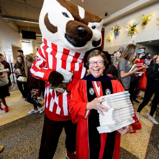 The Go Big Read program is sponsored by the office of UW–Madison Chancellor Rebecca Blank, shown preparing to hand out free copies of
