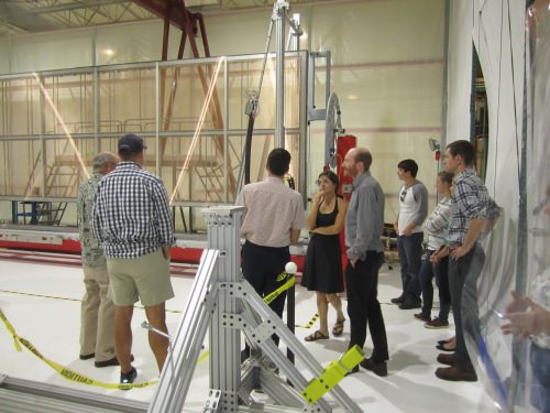 Photo: Group of people looking at equipment being built inside the Physical Sciences Lab