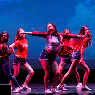 Members of the Korean and American Student Performers (KASPer) dance.