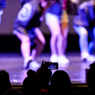 The performance of Korean and American Student Performers (KASPer) is captured through a smartphone.