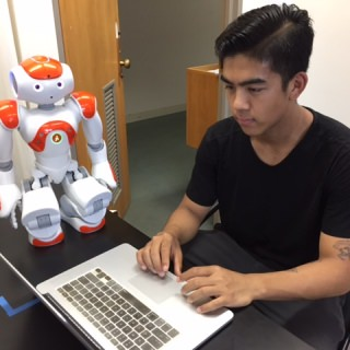 Jack Yang worked with the Computer Sciences Department to develop a robot that helps teach young children to read.
