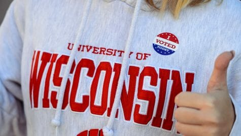 Photo: Wisconsin sweatshirt with I voted sticker on it