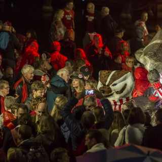 A crowd gathered around the newly unveiled statue of Bucky Badger.