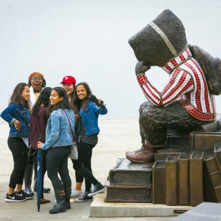 A group of students gather near the Bucky Badger statue in Alumni Park. The park is on the shore of Lake Mendota, adjoining the Memorial Union Terrace.