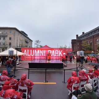 Chancellor Rebecca Blank addresses the crowd at the opening of Alumni Park on Oct. 6. All of the park's exhibits, panel walls, and fountain transform into illuminated displays once the sun goes down.
